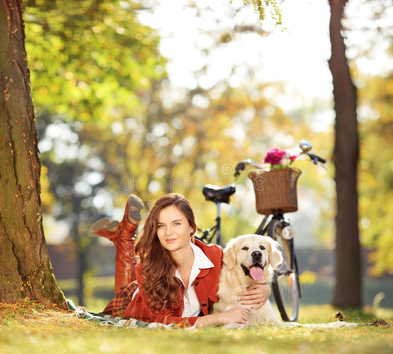 Download Pretty Female Lying Down With Labrador Retriever Dog In A Park Stock Image - Image of clothing, female: 34787057
