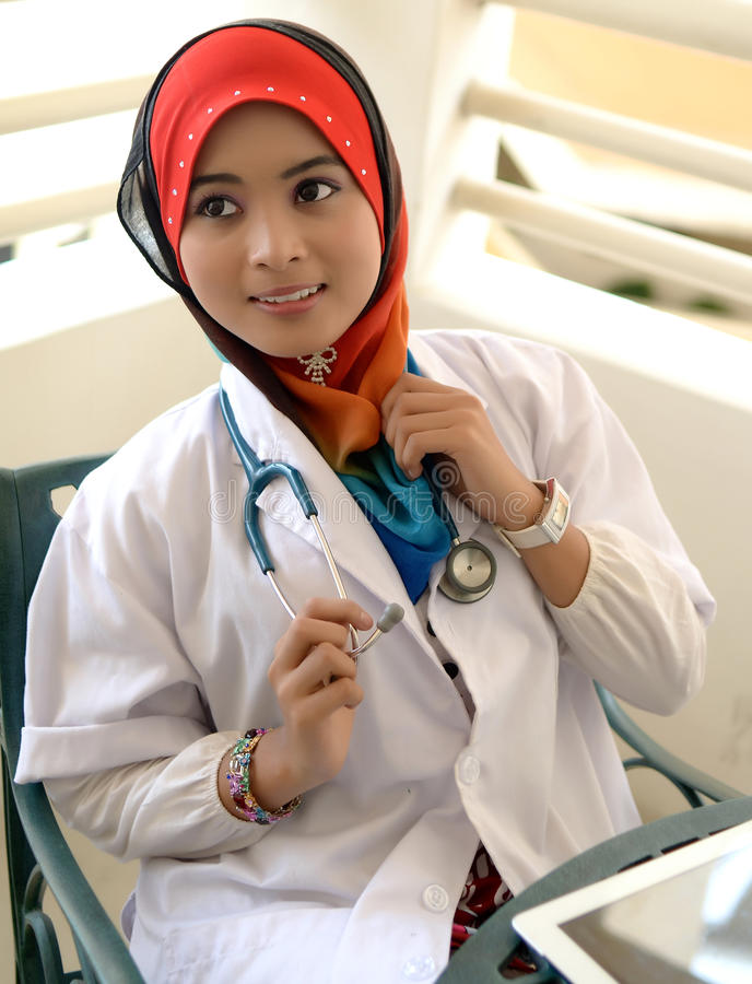 Pretty female Muslim doctor with stethoscope. stock photography