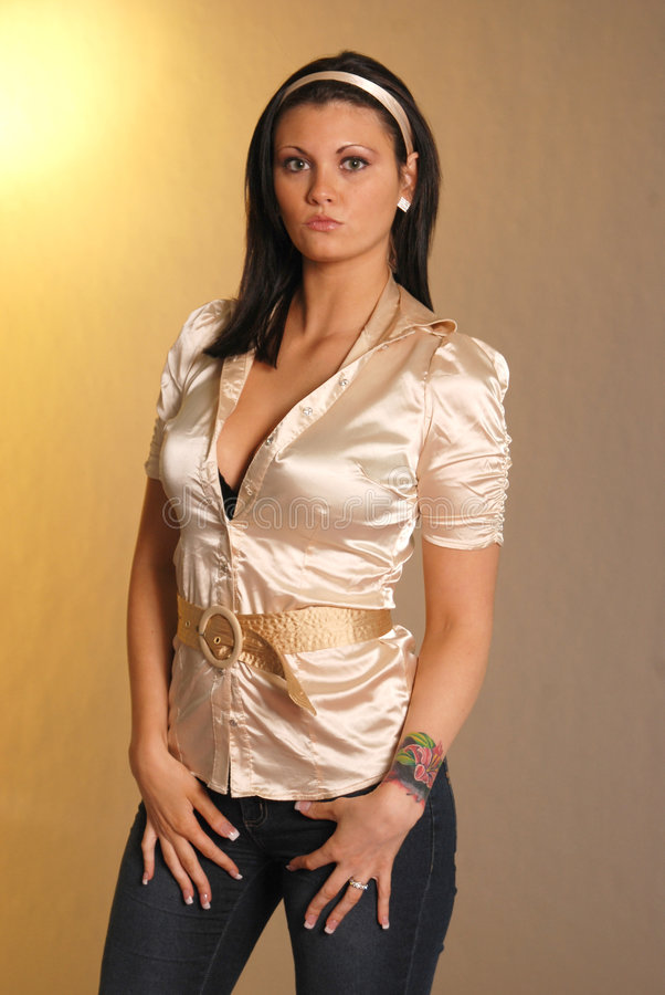 Pretty female in satin shirt royalty free stock photography