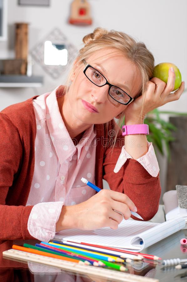College student girl doing homework at her desk stock photos