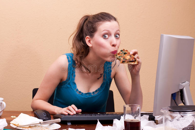 Pretty Female Student Eats A Piece Of Pizza Royalty Free Stock Photo
