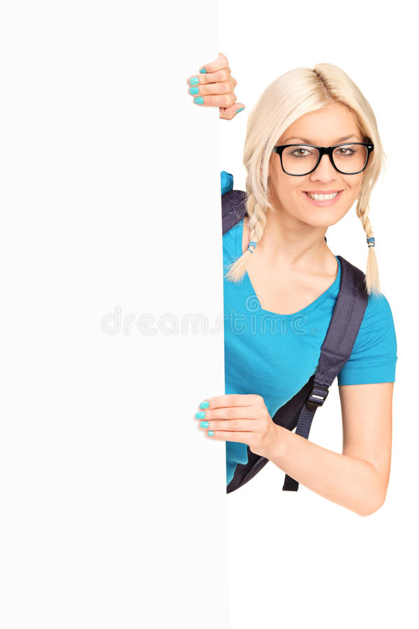 Download Pretty Female Student Posing Behind White Panel Stock Photo - Image: 26301558