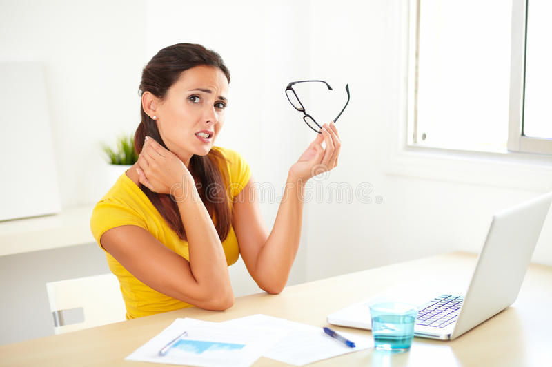 Pretty female suffering pain from torticollis royalty free stock image