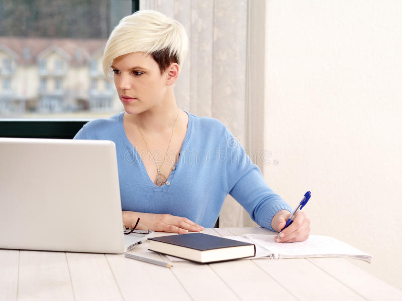 Pretty female working on laptop stock images
