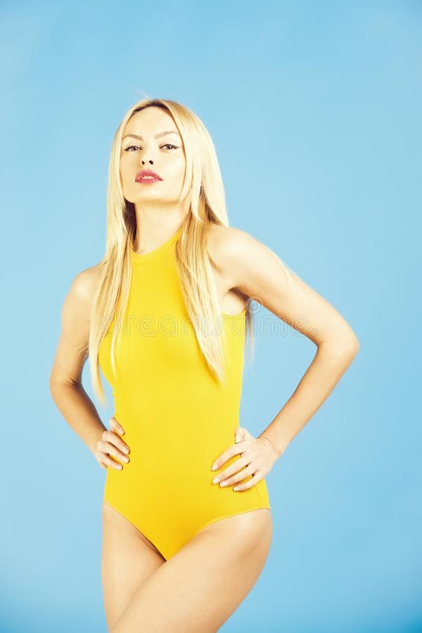 Pretty fit girl in yellow bodysuit. Sport fashion, Fitness and dieting. Pretty girl or woman, young, fit, fashion model with beautiful makeup, sexi lips, blond royalty free stock image