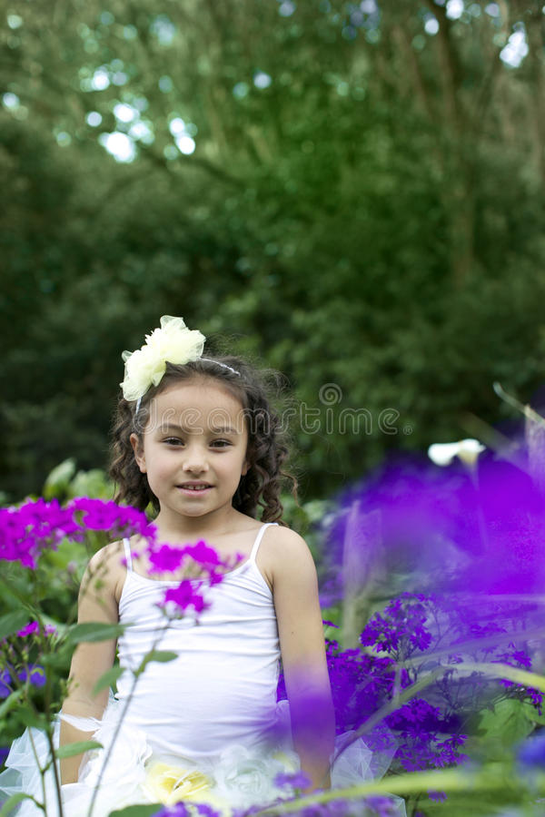 Pretty flower girl. stock photo