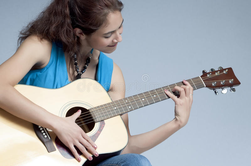 Pretty Folk Singer with Guitar stock photo