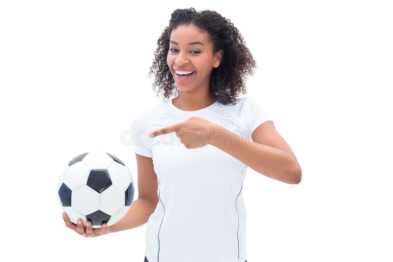 Download Pretty Football Fan In White Holding Ball And Pointing To It Stock Photo - Image of pretty, isolated: 42561492