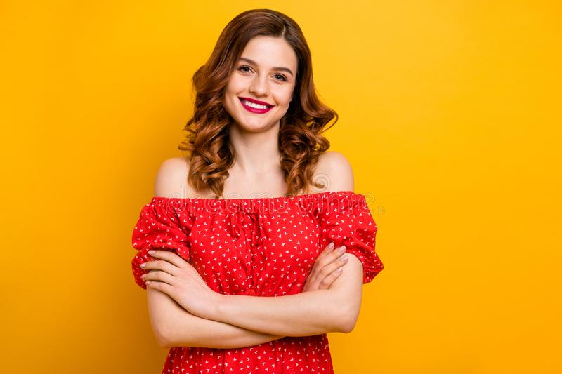 Pretty foxy lady hold arms crossed wear dress with open shoulders isolated yellow background stock image