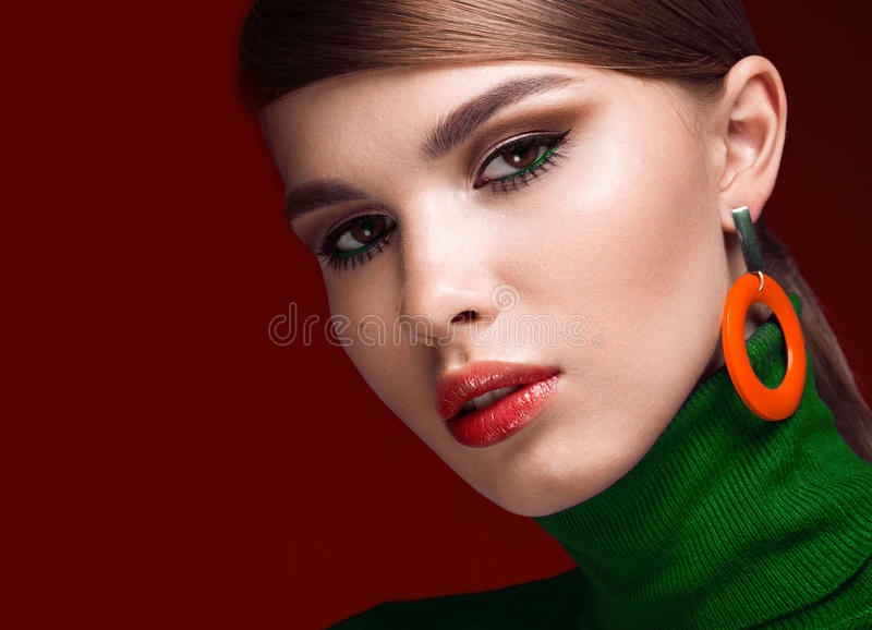 Pretty fresh girl, fashionable image of modern Twiggy with unusual eyelashes and bright accessories. royalty free stock photography