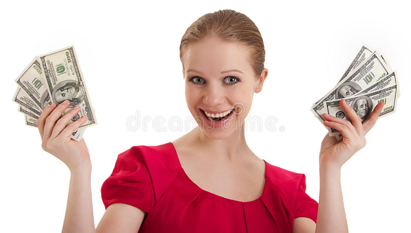 Pretty funny young woman holds the money. Pretty funny young woman in a red blouse holds the money, American dollars isolated on a white background stock images