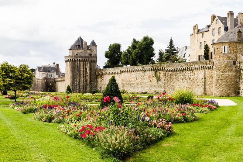 Medieval Ramparts and gardens at Vannes, Brittany, France. Pretty gardens with medieval stone walled ramparts and tower at Vannes , Brittany, France royalty free stock photo