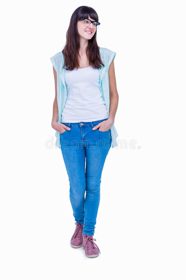 Pretty geeky hipster with hands in pocket looking away royalty free stock photos