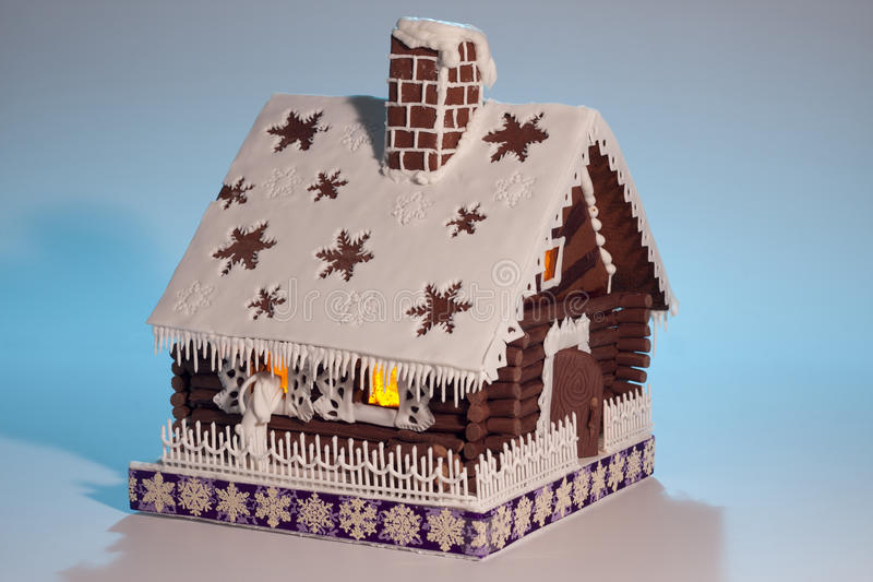 Pretty gingerbread house on light background stock photo
