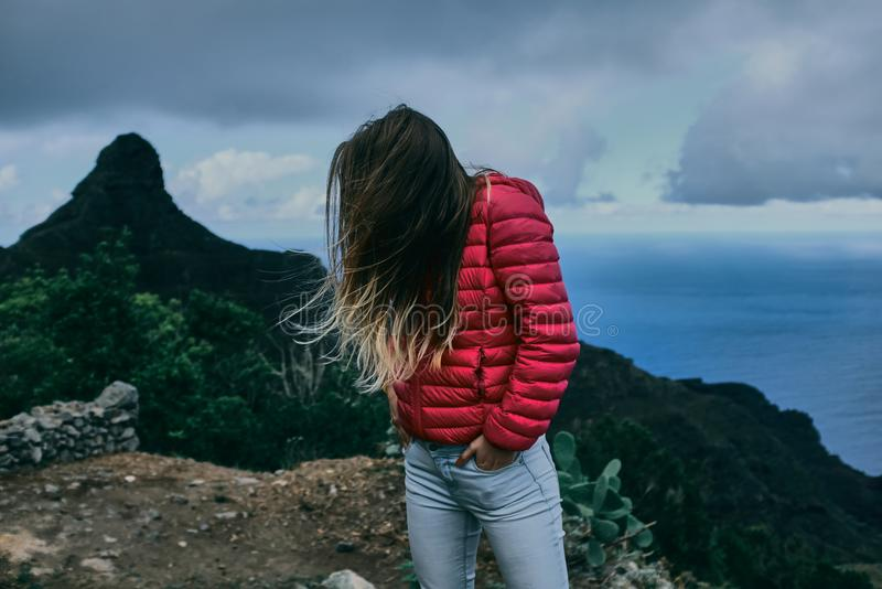 Pretty girl of background of mountain landscape royalty free stock photography