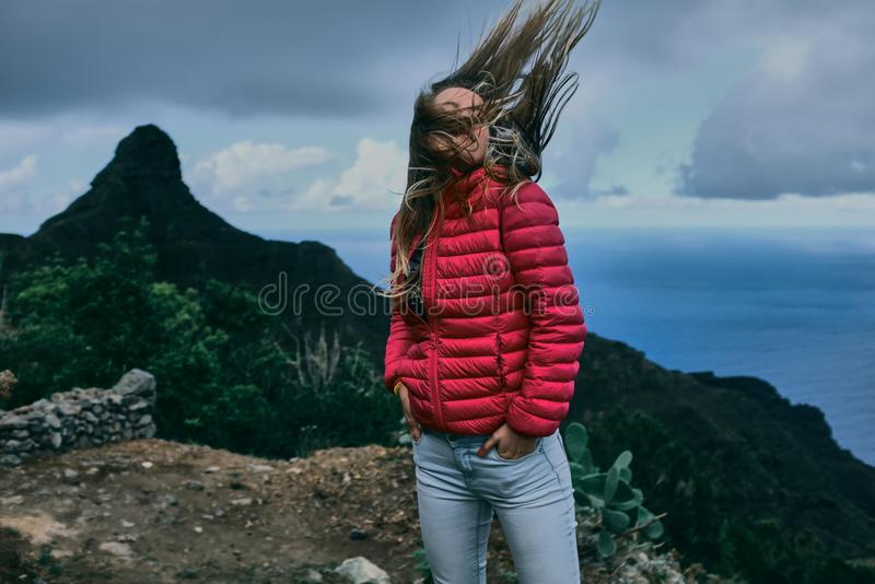 Pretty girl of background of mountain landscape royalty free stock image