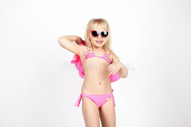 Pretty girl in bathing suit and glasses, having fun dancing and. Showing emotions, on white background, soft focus stock photos