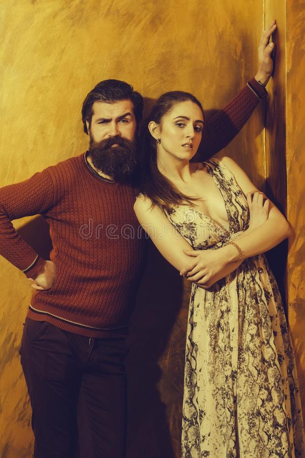 Pretty girl standing near bearded man with long beard stock images
