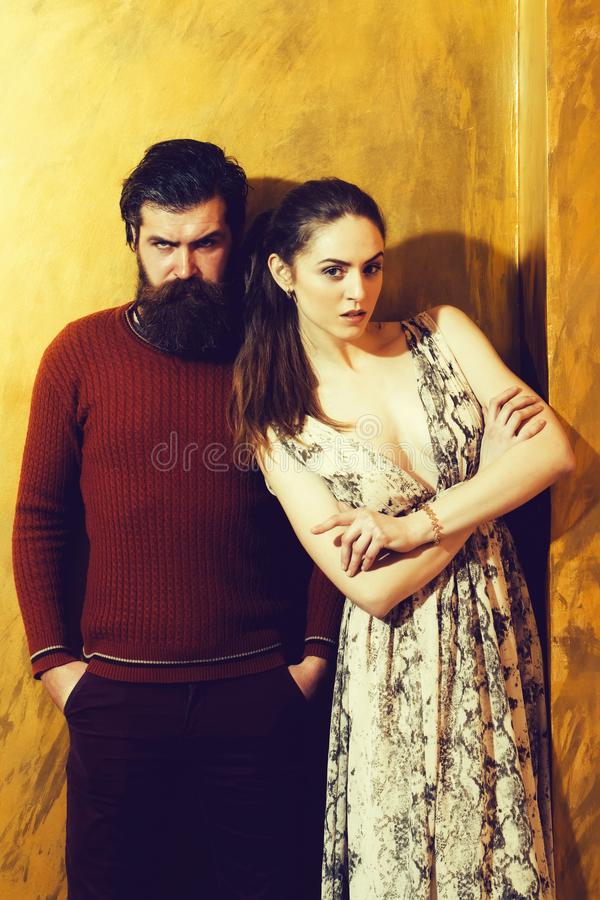 Pretty girl and serious bearded man with beard royalty free stock photo