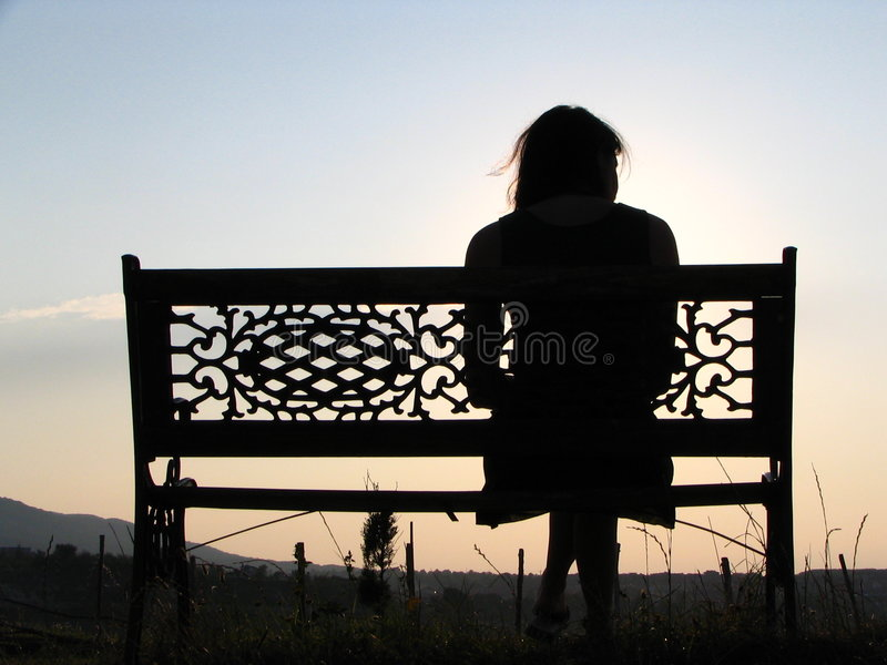 Pretty Girl On A Bench Stock Images