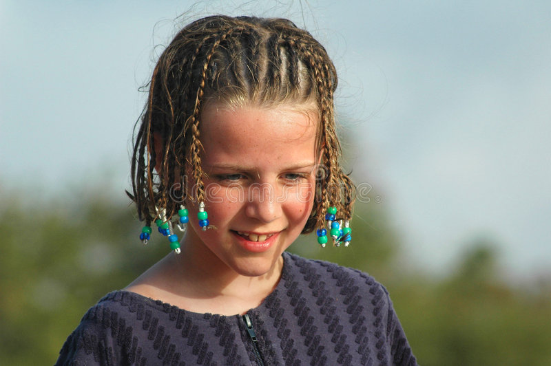 Pretty girl with braids in hair on beach. Candid portrait of child, nikon D70 royalty free stock images