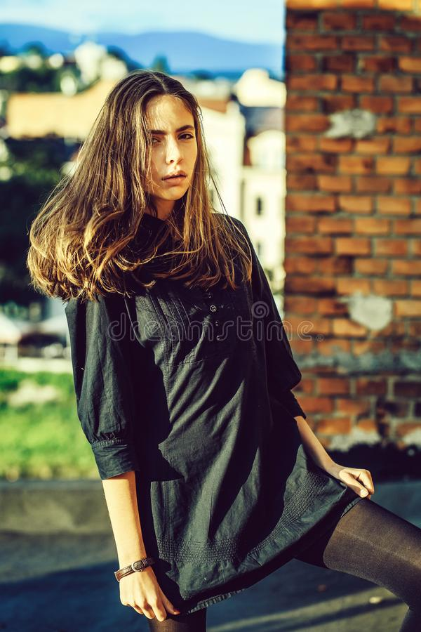 Pretty girl on brick wall royalty free stock images