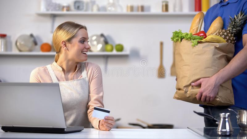 Pretty girl buying food online, immediate courier delivery, fast quality service royalty free stock photos