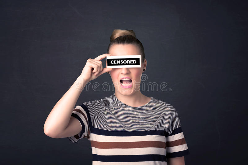 Pretty girl with censored paper sign. Holding in hand royalty free stock photography