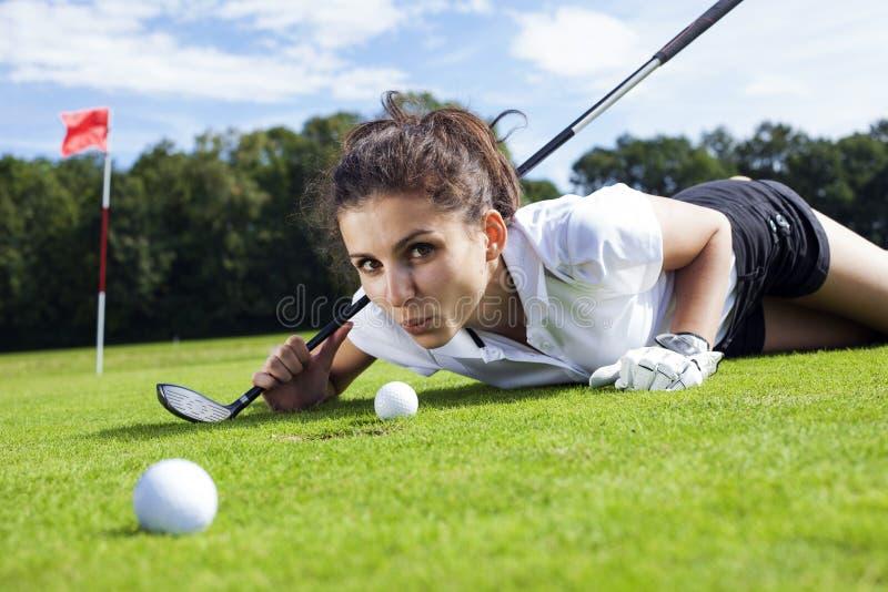 Pretty girl cheating on golf field