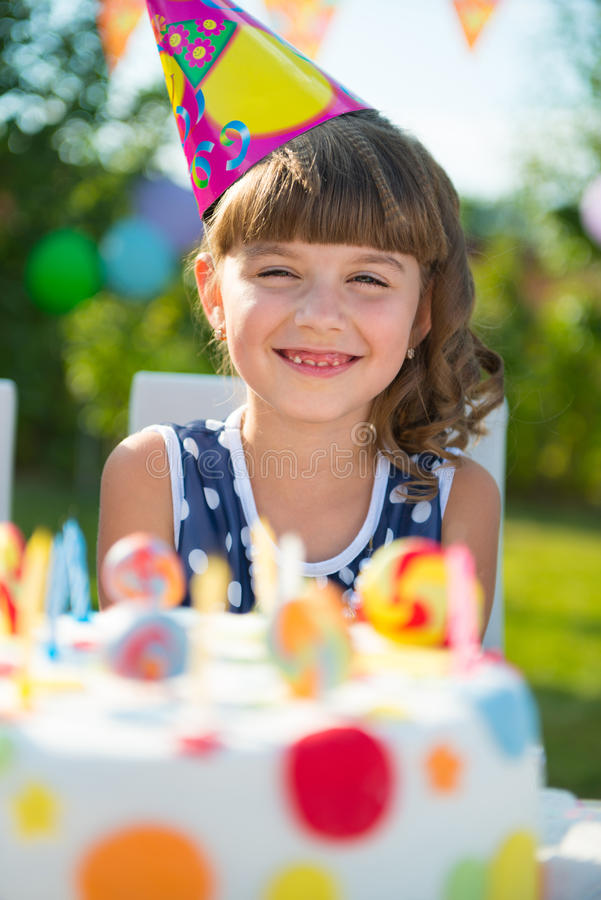 Pretty girl at child's birthday party royalty free stock image