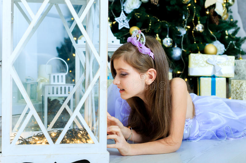 Pretty girl in christmas decorated interior royalty free stock photo