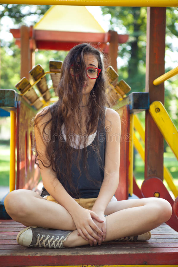 Download Pretty Girl On Climbing Frame In Park Stock Photo - Image: 33397190