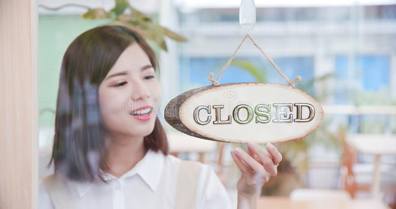 Pretty girl closed up the store stock photos