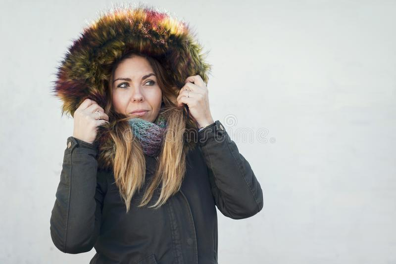 Pretty girl with coat in winter royalty free stock photo