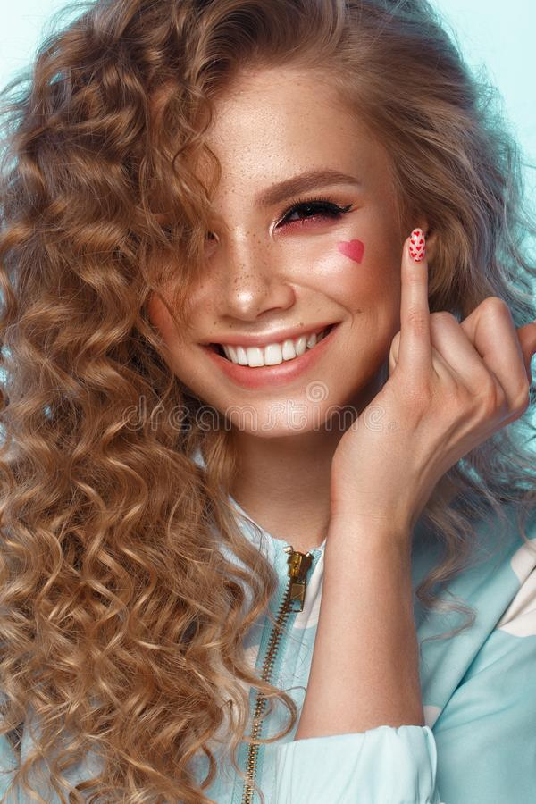 Pretty girl with curls hairstyle, classic makeup, freckles, nude lips Beauty face. stock images