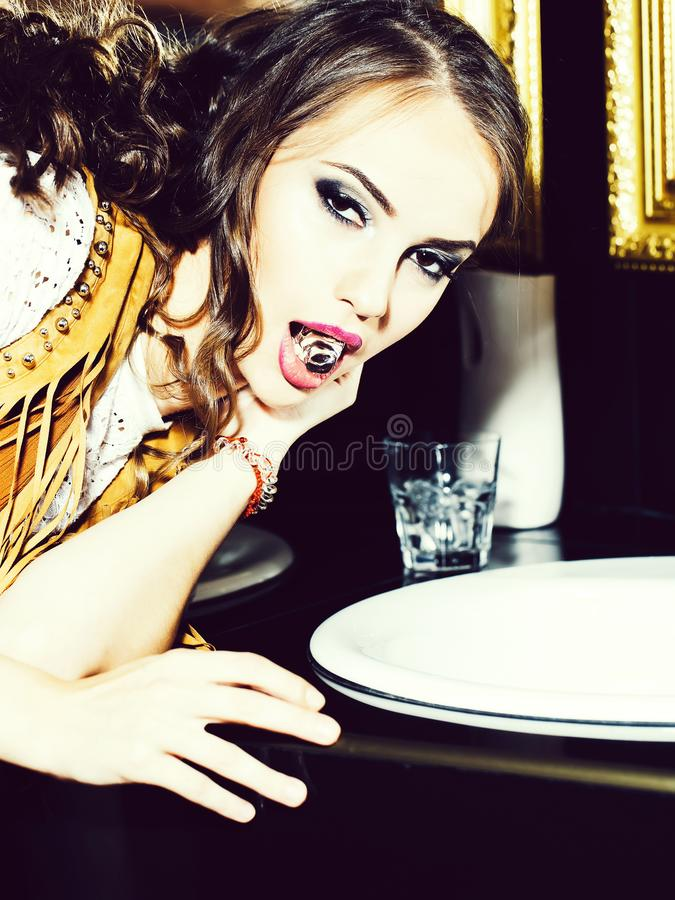 Pretty girl with ice cube. Pretty girl cute party fashion woman with evening makeup and ice cube in mouth in club bathroom royalty free stock photos