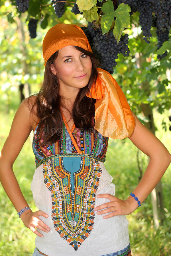 Pretty girl dressed like gypsy in vineyard royalty free stock photo