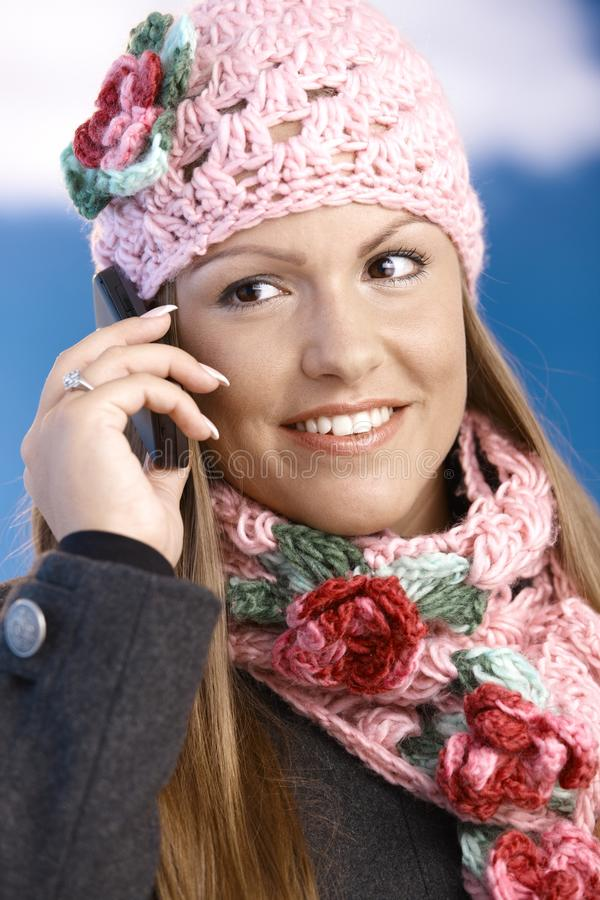 Download Pretty Girl Dressed Up Warm Smiling Using Mobile Stock Image - Image: 17164595