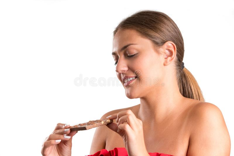 Pretty girl eating chocolate. isolated royalty free stock photos