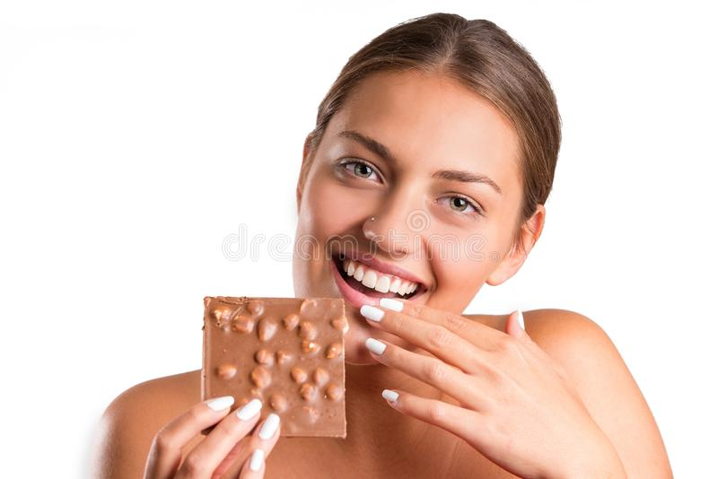 Pretty girl eating chocolate. isolated stock photography
