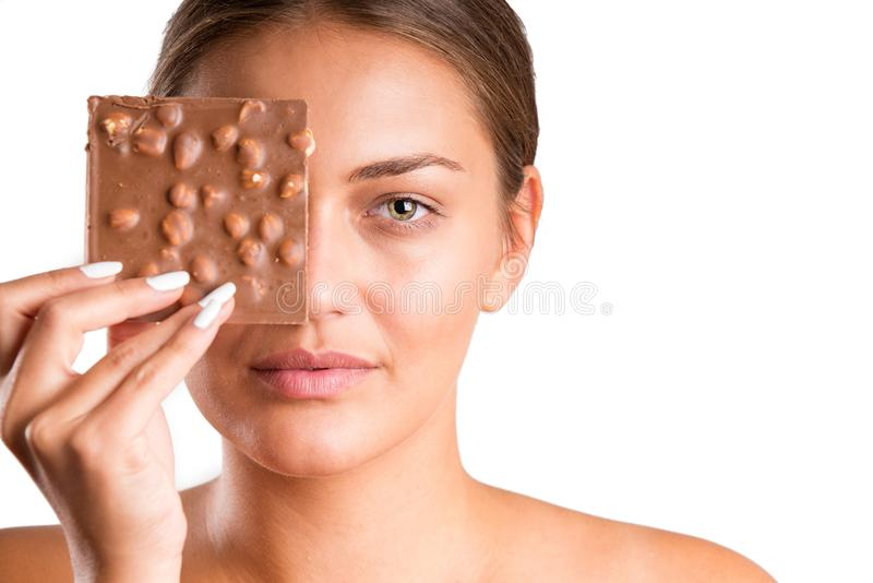 Pretty girl eating chocolate. isolated royalty free stock photography