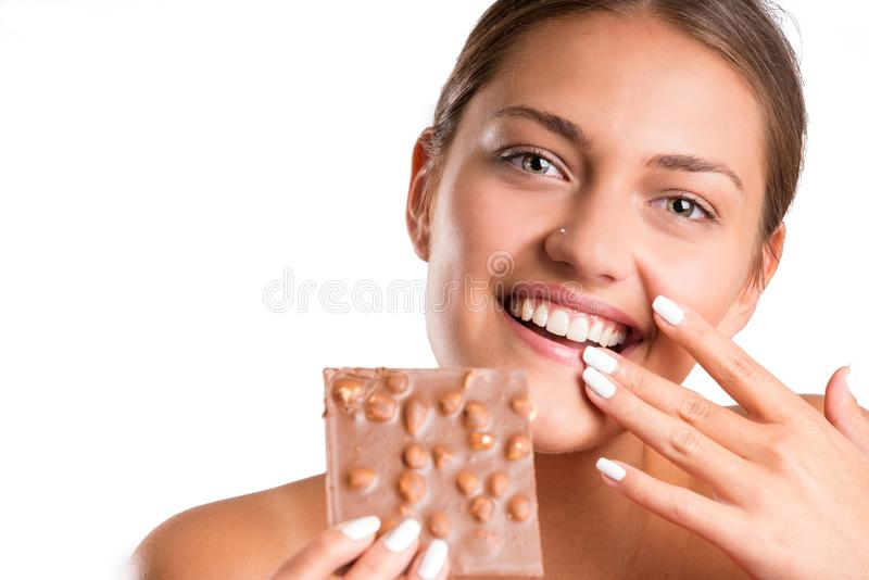 Pretty girl eating chocolate. isolated royalty free stock photo