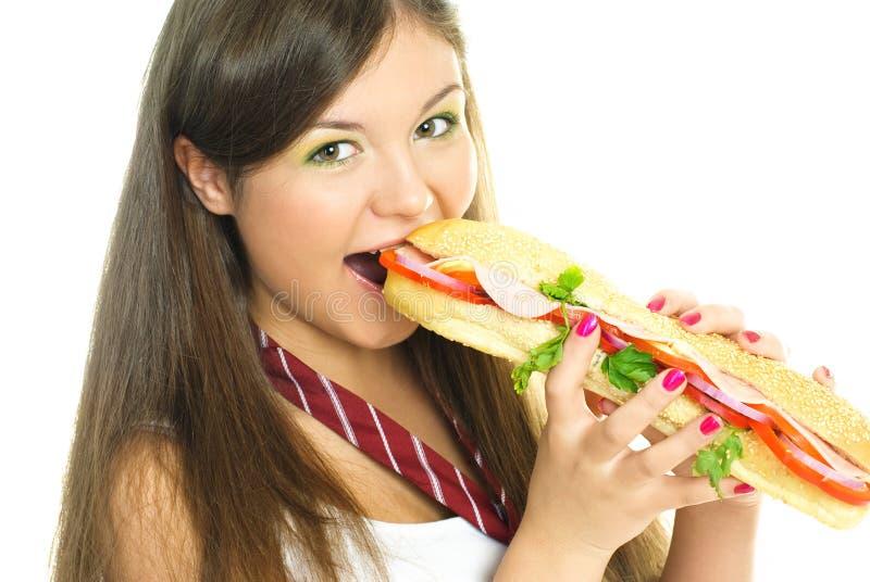 Pretty Girl Eating A Hot Dog Royalty Free Stock Photos