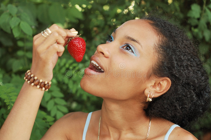 Download Pretty Girl Eating A Strawberry Stock Photo - Image of frizzy, fashion: 5409726