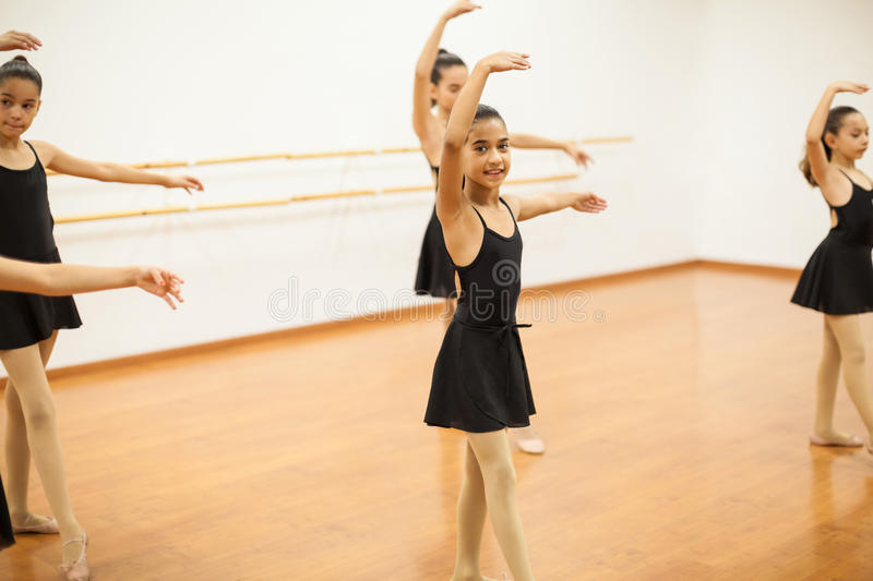 Pretty girl enjoying her dance class royalty free stock images