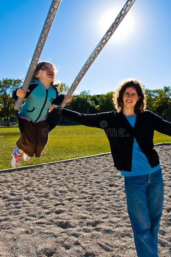 Download Pretty Girl Enjoys Swinging Stock Image - Image of kids, girls: 4484203