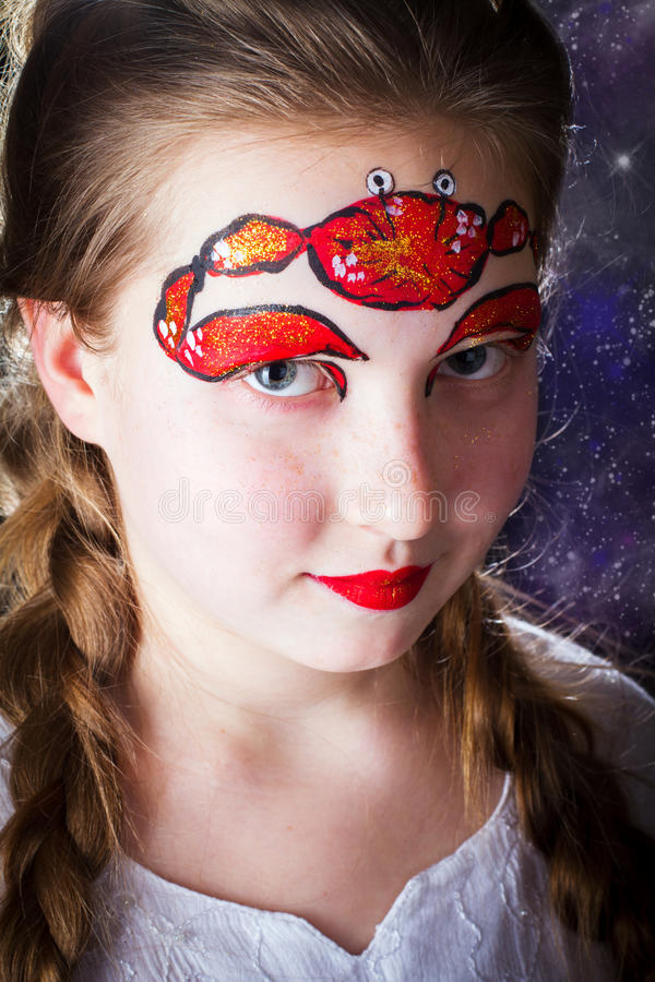 Pretty girl with face painting on black background royalty free stock image