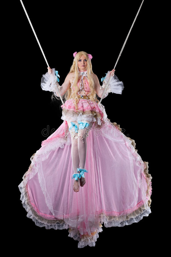 Pretty girl in fary-tale doll costume fly stock photo