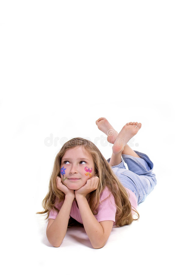 Pretty girl with flower butterfly make-up laying on the floor royalty free stock images