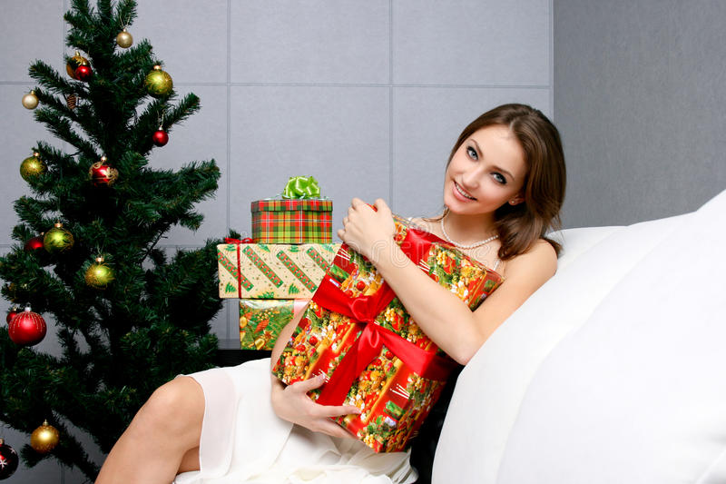 Download Pretty Girl With Gift Near The Christmas Tree Stock Photo - Image: 17241118